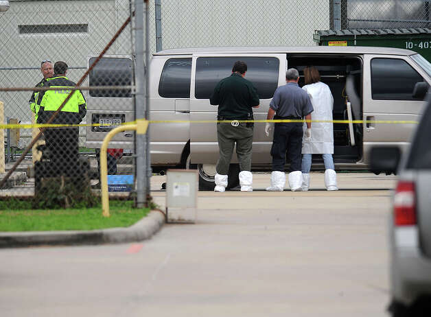 Crime scene officials investigate the Minnie Rogers Juvenile Justice Center after Orange County Deputy Fred Ashworth was shot by a 16-year-old boy while transporting him. The Deputy was taken to St Elizabeth for surgery and is expected to survive the incident.  Photo taken Thursday, January 26, 2012 Guiseppe Barranco/The Enterprise Photo: Guiseppe Barranco, STAFF PHOTOGRAPHER / The Beaumont Enterprise
