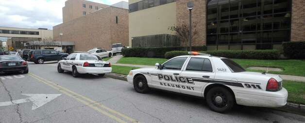 Police and Sheriff cars line the street outside the ambulance emergency room entrance of Christus St Elizabeth Hosipital.   Orange County Sheriff Deputy Fred Ashworth was shot Thursday morning while taking a juvenile back inside the Minnie Rogers Juvenile Justice Center. His is at St. Elizabeth Hospital and is expected to recover from the two gunshot wounds according to law enforcement officials. Dave Ryan/The Enterprise