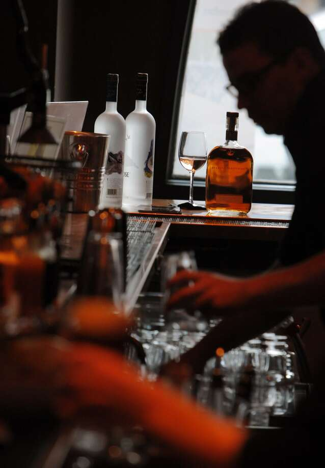 Bartenders at work at Reed and Greenough on Scott Street in San Francisco, Calif., shown here on Wednesday, August 15, 2012. The bar offers a potential viewing spot for the America's Cup race in the Summer of 2013. (Carlos Avila Gonzalez / The Chronicle)