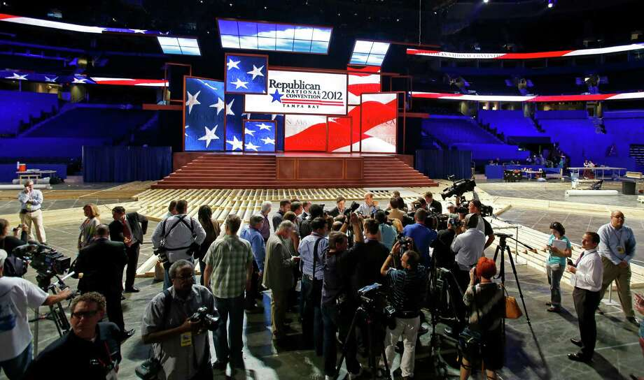 Members of the media conduct interviews on the floor after the unveiling of the stage and podium for the 2012 Republican National Convention, Monday, Aug. 20, 2012, at the Tampa Bay Times Forum in Tampa, Fla. (AP Photo/Scott Iskowitz) Photo: Scott Iskowitz, Associated Press / FRE170674 AP
