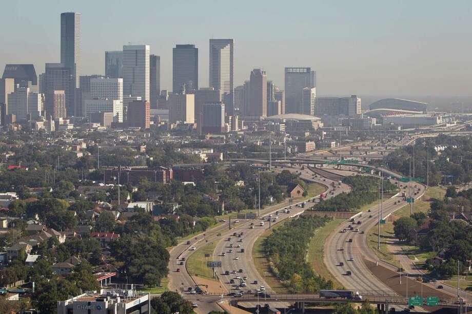 A hazy downtown Houston skyline seen in 2010. Photo: Michael Paulsen, Houston Chronicle / Houston Chronicle