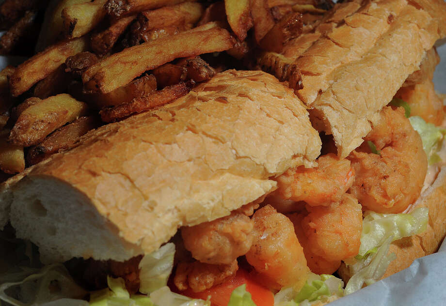 Shrimp po' boy with remoulade and French fries at Zydeco in Beaumont. Photo taken Friday, February 3, 2012 Guiseppe Barranco/The Enterprise Photo: Guiseppe Barranco, STAFF PHOTOGRAPHER / The Beaumont Enterprise