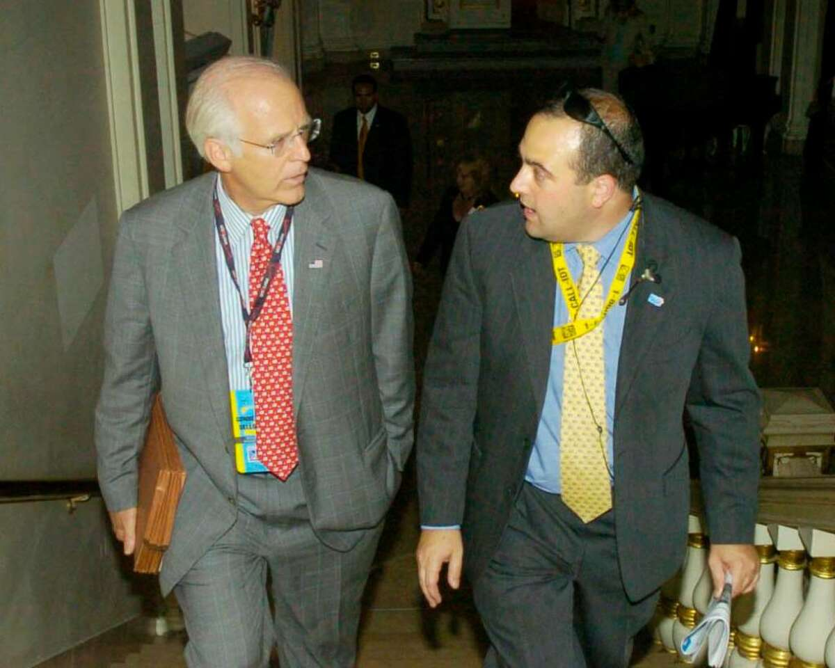 Former U.S. Rep. Christopher Shays, left, makes his way to the ballroom at The Plaza hotel in New York, with his former campaign manager, Michael Sohn, right, in 2004. Sohn was arrested today, Friday, Dec. 4, by the FBI and IRS on federal embezzlement charges.