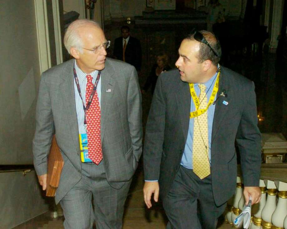 Former U.S. Rep. Christopher Shays, left, makes his way to the ballroom at The Plaza hotel in New York, with his former campaign manager, Michael Sohn, right, in 2004.  Sohn was arrested today, Friday, Dec. 4,  by the FBI and IRS on federal embezzlement charges. Photo: Kathleen O'Rourke / Stamford Advocate