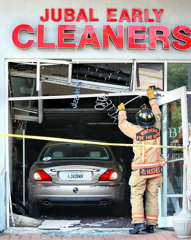 I SAID NO STARCH! Firefighter David Hughes removes a wrecked sign