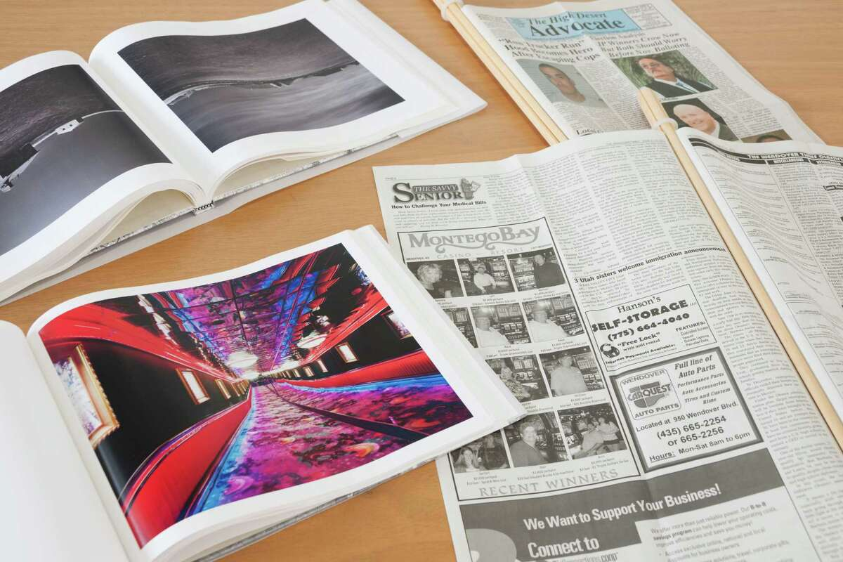 """Weekly newspapers and a book of photos are part of Mike Osborne's Artpace installation """"Floating Island."""""""