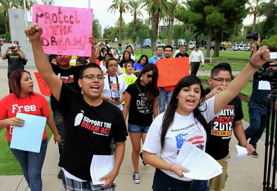 """Young illegal immigrants protest a recent executive order in Arizona to deny them drivers licenses and other public benefits. With President Obama overhauling immigration enforcement, the issue has resurfaced, and some readers took exception to a recent story that started illegal immigrants could be """"law-abiding."""" Photo: Ross D. Franklin, Associated Press / AP"""