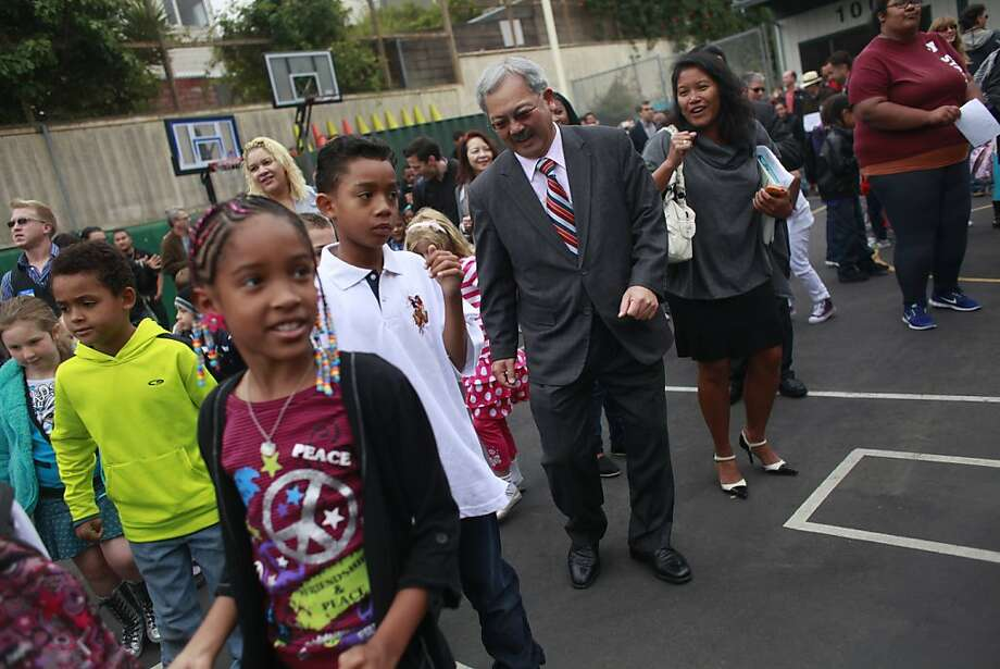 Mayor Ed Lee (top, center) and school board member Hydra Mendoza join students at Harvey Milk Civil Rights Academy on opening day Monday. Photo: Lea Suzuki, The Chronicle