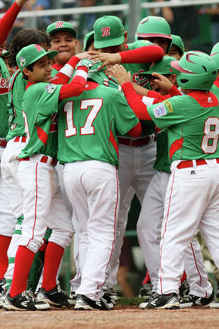 Nuevo Laredo, Tamaulipas teammates surround Gerardo Moreno, (17), after a homerun in the second inning against Vancourver, British Columbia in Game five of the 2012 Little League World Series in South Williamsport, Pennsylvania, Friday, Aug. 17, 2012. Photo: Jerry Lara, San Antonio Express-News / © 2012 San Antonio Express-News