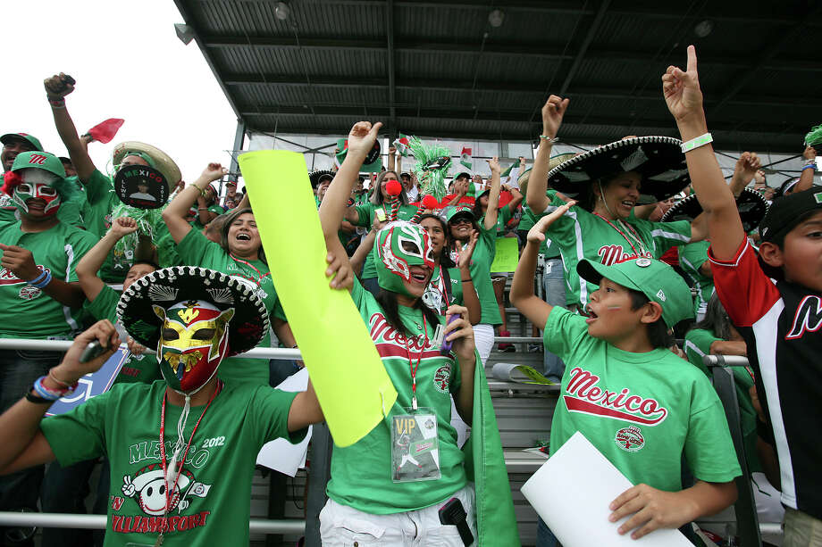The Nuevo Laredo delegation — including Angel Guerrero, 14 (front, from left); Ana Moreno, 24; and Antonio Mireles, 11 — cheer after a hit during Friday's game against Canada in South Williamsport, Pa. Photo: Jerry Lara, San Antonio Express-News / © 2012 San Antonio Express-News