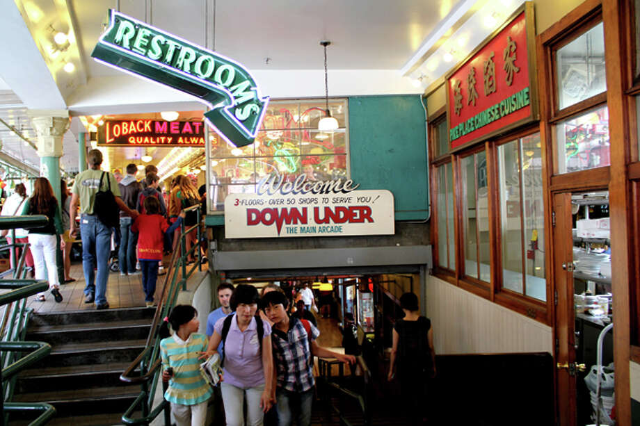 "Pike Place Market hosts over 10 million visitors annually, and the lines for the public restrooms ""Down Under"" are usually long midday. Photo: Rachel Reed"