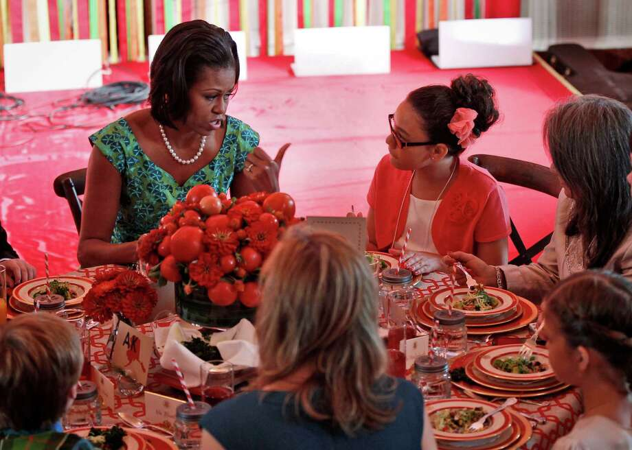"First lady Michelle Obama talks with Illana Gonzalez-Evans, from Washington, during the Kids' ""State Dinner,"" Monday, Aug. 20, 2012, in the East Room of the White House in Washington. (AP Photo/Pablo Martinez Monsivais) Photo: AP"