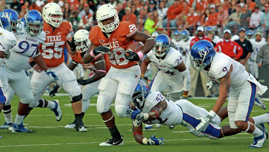 Dubbed by UT coach Mack Brown as the Longhorns' most consistent back in the preseason, Malcolm Brown (center) has the power to gain yards inside and the quickness to get around the edge. Photo: Tom Reel, San Antonio Express-News / © 2011 San Antonio Express-News