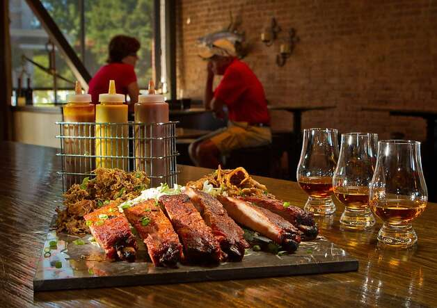 The Smokin' BBQ Platter with a whiskey flight at Bounty Hunter in Napa, where the happy hour, top, runs from 3 to 6 p.m. Tuesday through Friday. Photo: John Storey, Special To The Chronicle