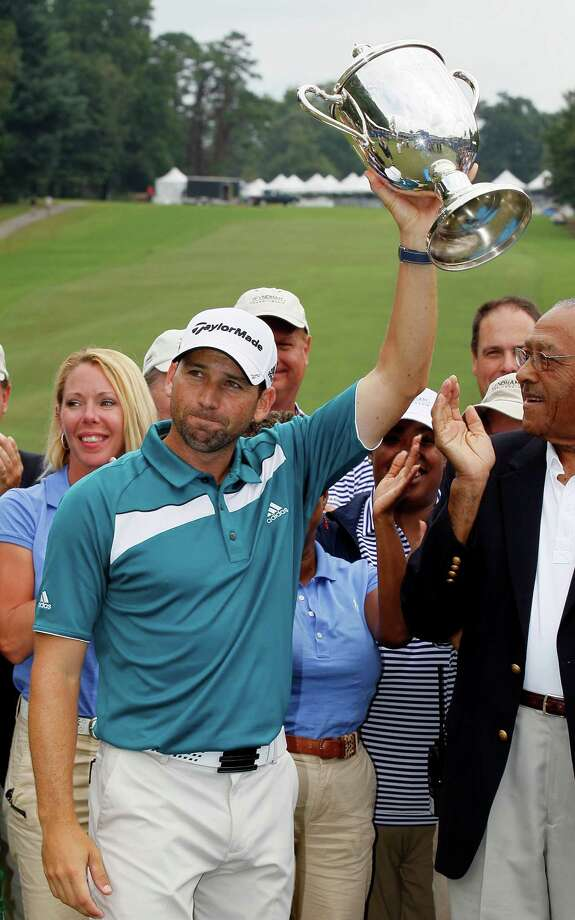 Sergio Garcia, of Spain, raises the Sam Snead Cup after winning the rain delayed Wyndham Championship golf tournament in Greensboro, N.C., Monday, Aug. 20, 2012. Photo: Gerry Broome, Associated Press / AP