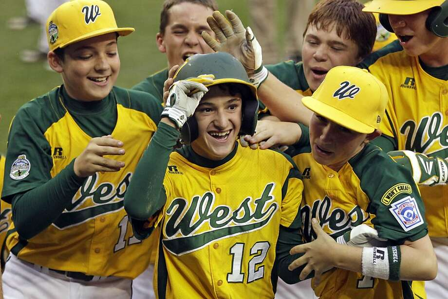 Petaluma's Danny Marzo (12) celebrates with teammates after his solo home run in the bottom of the eighth beat Parsippany, N.J., in an elimination game. Photo: Gene J. Puskar, Associated Press
