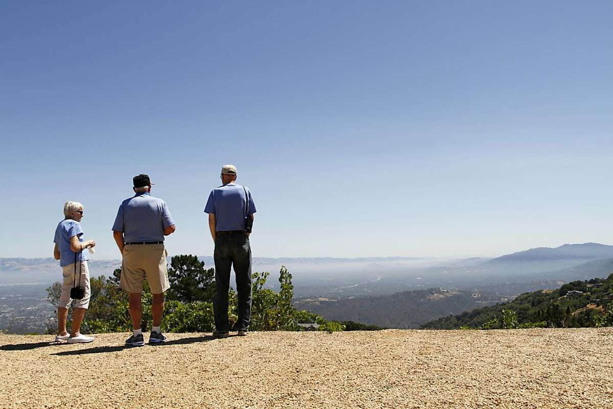 Kay Hudson (left), Early Carrier (center), and Washburn Cabuines (right) take a look from the top of Ridge winery. Ridge is located at the very top of the Santa Cruz mountains.