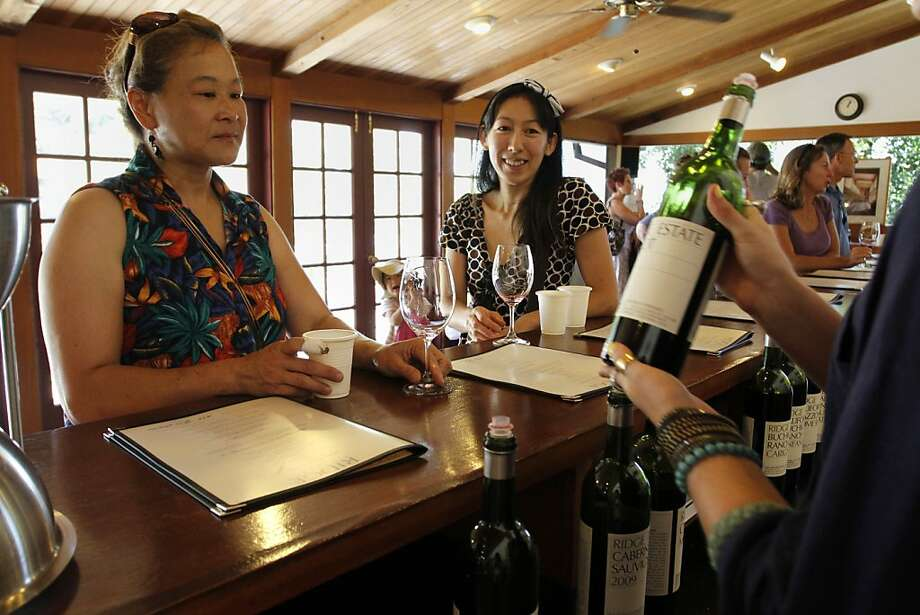 Jeannie Llewellyn (left) and Yoko Tsuno taste wine at Ridge Vineyards. Photo: Sean Culligan, The Chronicle