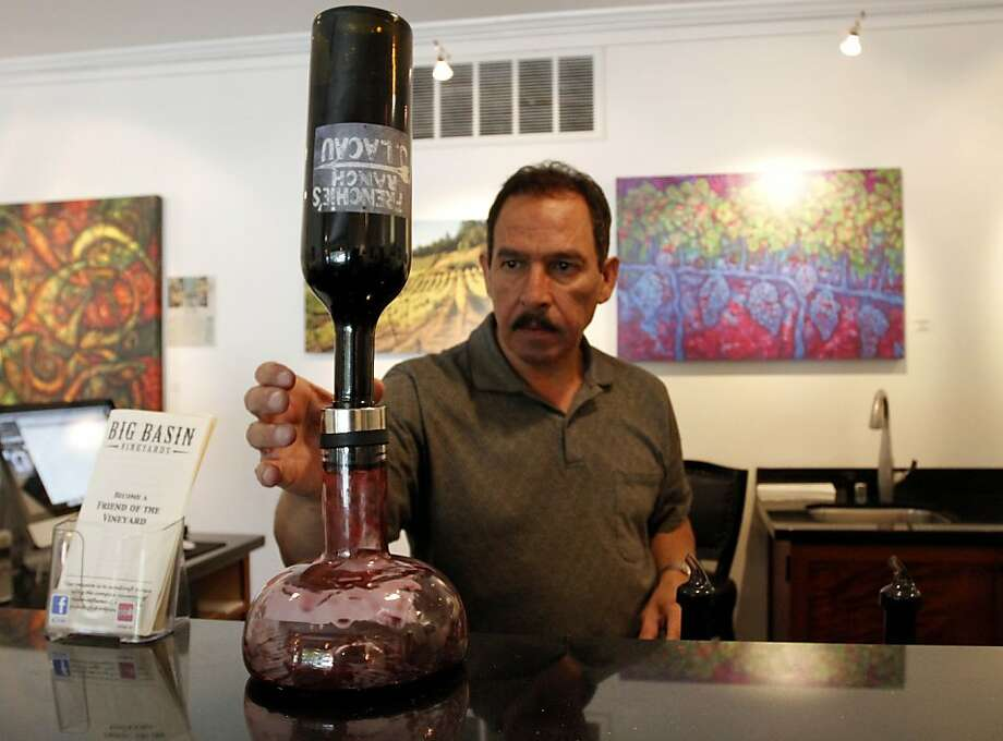 Tom Simental decants a bottle of wine at Big Basin Vineyards in Saratoga, which was founded in 1998. Photo: Sean Culligan, The Chronicle