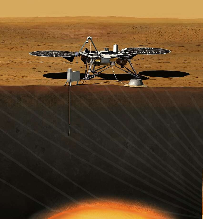 The InSight spacecraft  takes Mars' temperature by hammering a heat-flow recorder 15 feet or more beneath the planet's sand and rocks in this artist's rendering. The mission will follow on the heels of the recently successful landing of the rover Curiosity. Photo: Associated Press