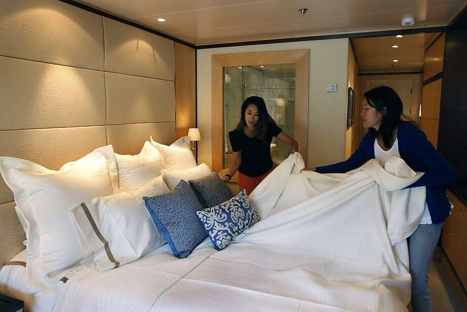 Susan Whang (left) and Alex Cheng have to work quickly on a project by Kendall Wilkinson Design & Home aboard the World. Photo: Paul Chinn, The Chronicle