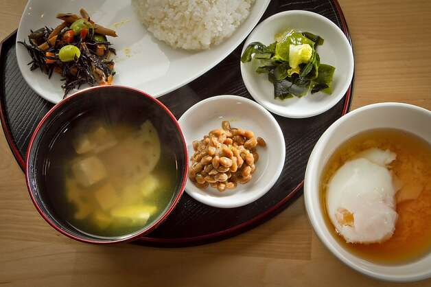 Cassava Bakery + Cafe is a tiny place that offers a Japanese breakfast, above, on weekends that includes miso soup, wakame salad, citrus-spiked natto, rice and hard-to-find onsen tamago, an egg traditionally poached in hot spring water and served in a dashi broth. Photo: John Storey, Special To The Chronicle