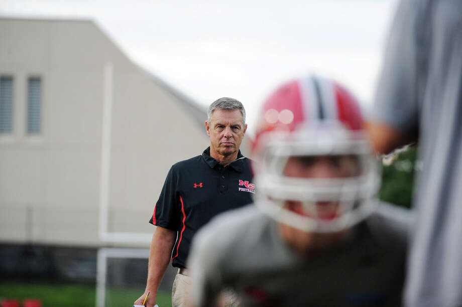 Rams Coach Lou Marinelli watches over football practice at New Canaan High School in New Canaan, Conn., August 20, 2012. Photo: Keelin Daly / Stamford Advocate
