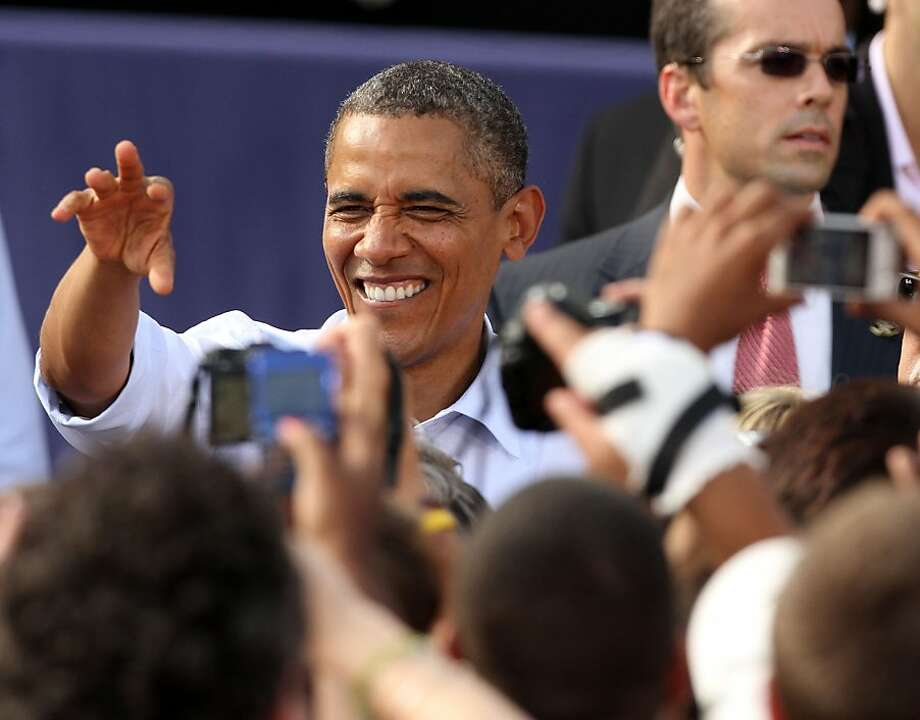 President Barack Obama greets supporters during a campaign stop Saturday, Aug. 18, 2012 in Rochester, N.H. Photo: Jim Cole, Associated Press
