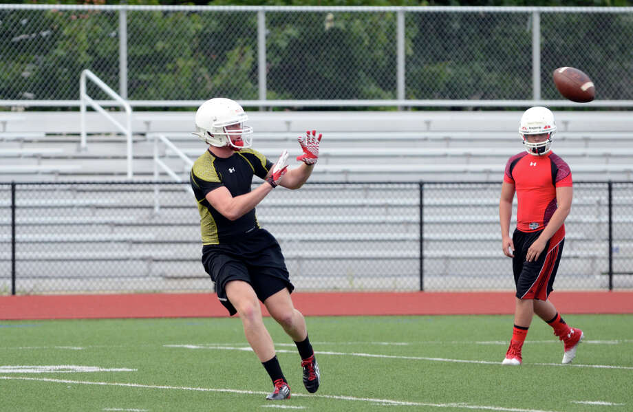 Greenwich High School football captain Joe Kelly runs drills during the first day of football practice at Greenwich High School on Monday, Aug. 20, 2012. Photo: Amy Mortensen / Connecticut Post Freelance