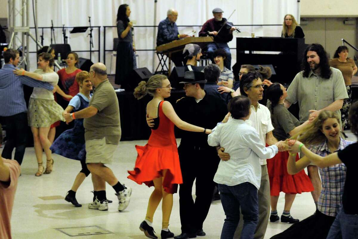 Jeff Pelletier and Kat Baxter, center, join other dancers as they take part in a swing and contra dance program lead by Susan Petrick and the Fennig's All-Stars as part of Dance Flurry 2012 in Saratoga Springs , N.Y. Saturday Feb.18, 2012. ( Michael P. Farrell/Times Union archive)
