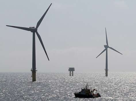 Wind egines are seen from the research platform FINO1 near the off-shore wind farm Alpha Ventus, near the island Borkum, northern Germany, on August 20, 2012. AFP PHOTO /POOL/ FOCKE STRANGMANNFOCKE STRANGMANN/AFP/GettyImages Photo: Focke Strangmann, AFP/Getty Images