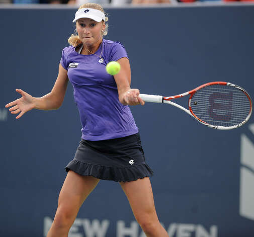 Russian Ekaterina Makarova hits a forehand during her opening round loss to four time defending champion Caroline Wozniacki at the New Haven Open at Yale tennis tournament on Monday, August 20, 2012. Photo: Brian A. Pounds, Brian A. Pounds/Connecticut Post / Connecticut Post