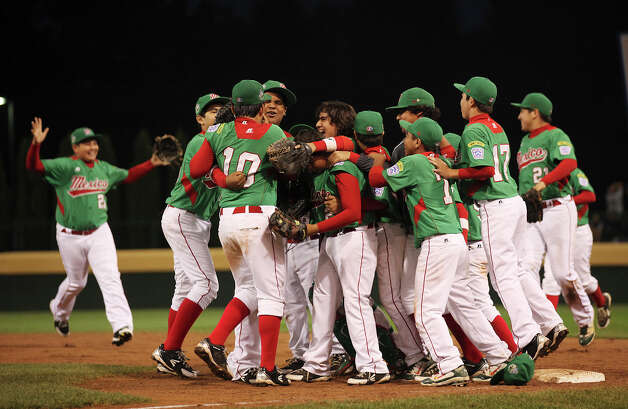 Nuevo Laredo, Tamaulipas celebrates their victory over Chinese Taipei in an elimination game at the 2012 Little League World Series in South Williamsport, Pennsylvania, Monday, Aug. 20, 2012. Nuevo Laredo won 4-3 to stay in contention. Photo: Jerry Lara, San Antonio Express-News / © 2012 San Antonio Express-News