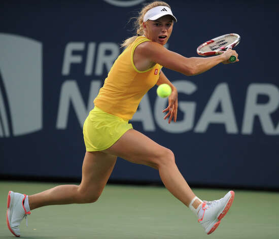 Four time defending champion Caroline Wozniacki chases down a backhand in her opening round match against Ekaterina Makarova at the New Haven Open at Yale on Monday, August 20, 2012. Photo: Brian A. Pounds, Brian A. Pounds/Connecticut Post / Connecticut Post