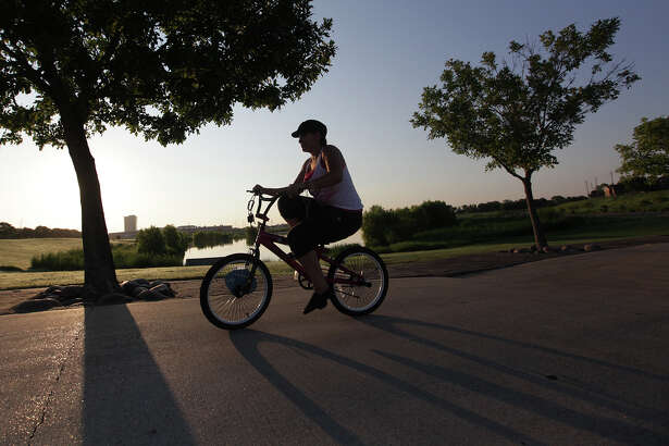 """Weather feels good this morning"" says Melissa Garcia, 20, while riding up hill at Harris County Arthur Storey Park on Monday, Aug. 20, 2012, in Houston. Weather expected to be sunny and muggy today."