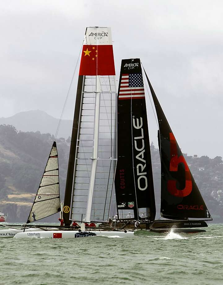 The catamarans will be out in force off Marina Green on Tuesday for practice racing for the America's Cup World Series. The AC Village opens at 10 a.m. Photo: Michael Macor, The Chronicle