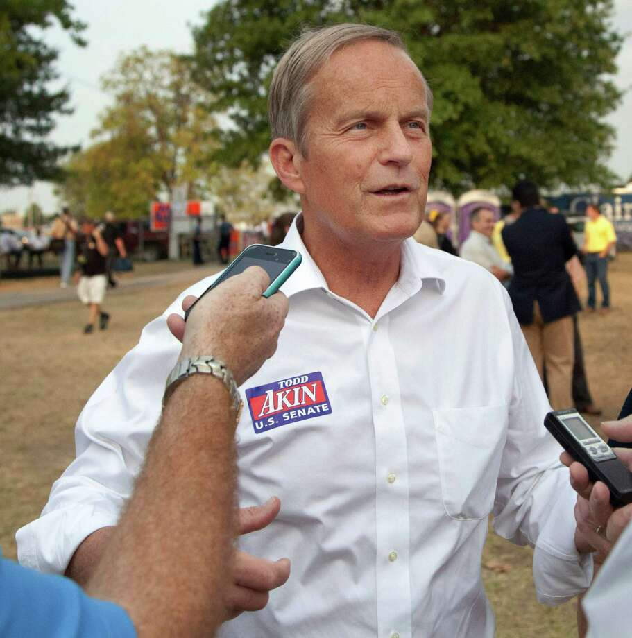 "In this Thursday, Aug. 16, 2012 photograph, Rep. Todd Akin, R-Mo., talks with reporters while attending the Governor's Ham Breakfast at the Missouri State Fair in Sedalia, Mo. Akin was keeping a low profile, Monday, Aug. 20, 2012, a day after a TV interview in which he said that women's bodies can prevent pregnancies in ""a legitimate rape"" and that conception is rare in such cases. (AP Photo/Orlin Wagner) Photo: Orlin Wagner, Associated Press / AP"