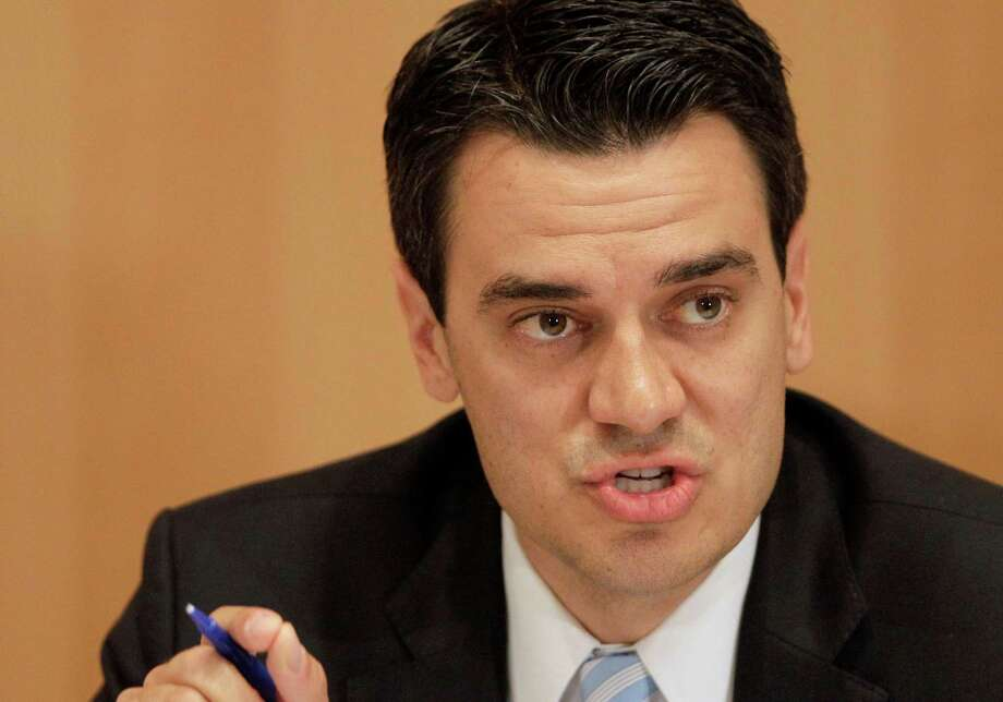 FILE - In this Oct. 6, 2010 file photo, Kevin Yoder participates in a debate in Overland Park, Kan. The conservative Republican congressman, unopposed for re-election in Kansas' 3rd District, has apologized for any offense caused by his naked swim in the Sea of Galilee last summer. (AP Photo/Charlie Riedel, File) Photo: Charlie Riedel / AP
