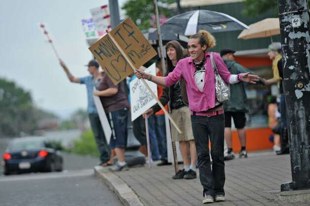Christopher Perrigo of Albany, right, and others protest the city?s new cabaret licenses, at Townsend Park on Monday evening Aug. 20, 2012 in Albany, NY. It is being organized by DJs, bar owners, employees and patrons to voice opposition to the new cabaret licenses? requirement that bars and nightclubs stop live music, DJs and karaoke at 2 a.m. on weekends and, for some bars depending on location, at midnight during the week. They later marched to City Hall. (Philip Kamrass / Times Union) Photo: Philip Kamrass / 00018922A