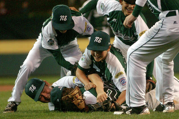 New England team members pile onto pitcher Will Lucas after they defeated Great Lakes 4-0, during 2012 Little League World Series game action in South Williamsport, Penn. on Monday August 20, 2012. Photo: Christian Abraham / Connecticut Post