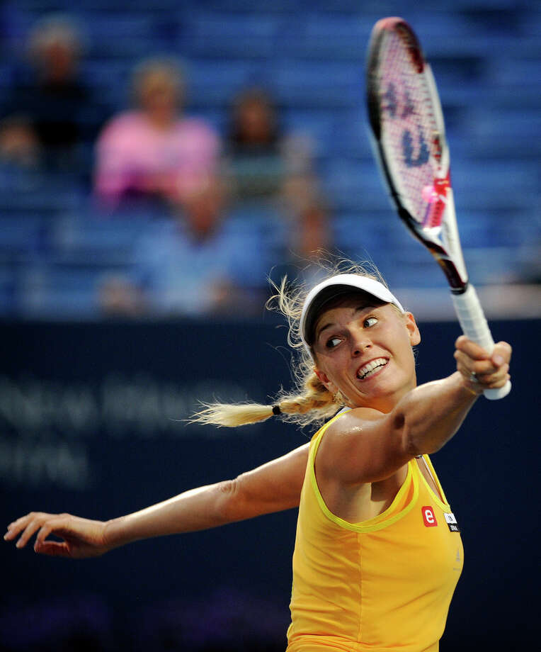 Caroline Wozniacki, of Denmark, returns to Ekaterina Makarova, of Russia, during their opening round match at the New Haven Open tennis tournament, Monday, Aug. 20, 2012, in New Haven, Conn. Wozniacki won 6-3, 6-3. Photo: The Connecticut Post, Brian A. Pounds