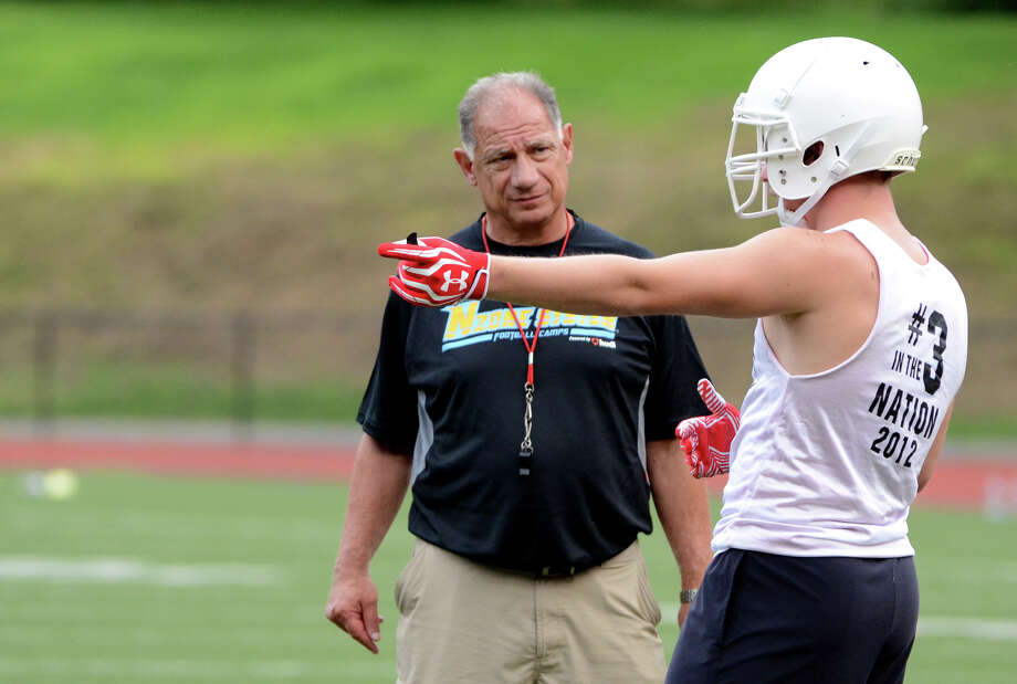 Head football coach Rich Albonizio talks to Greenwich football captain Alex McMurray during the first day of football practice at Greenwich High School on Monday, Aug. 20, 2012. Photo: Amy Mortensen / Connecticut Post Freelance