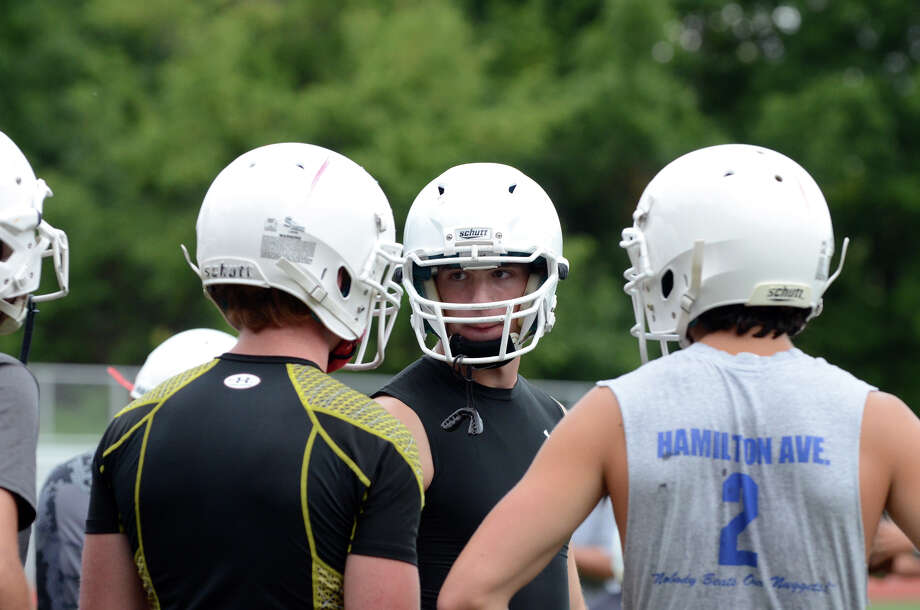 Greenwich High School football captain Taylor Olmstead, facing camera, talks to teammate and co-captain Joe Kelly during the first day of football practice at Greenwich High School on Monday, Aug. 20, 2012. Photo: Amy Mortensen / Connecticut Post Freelance