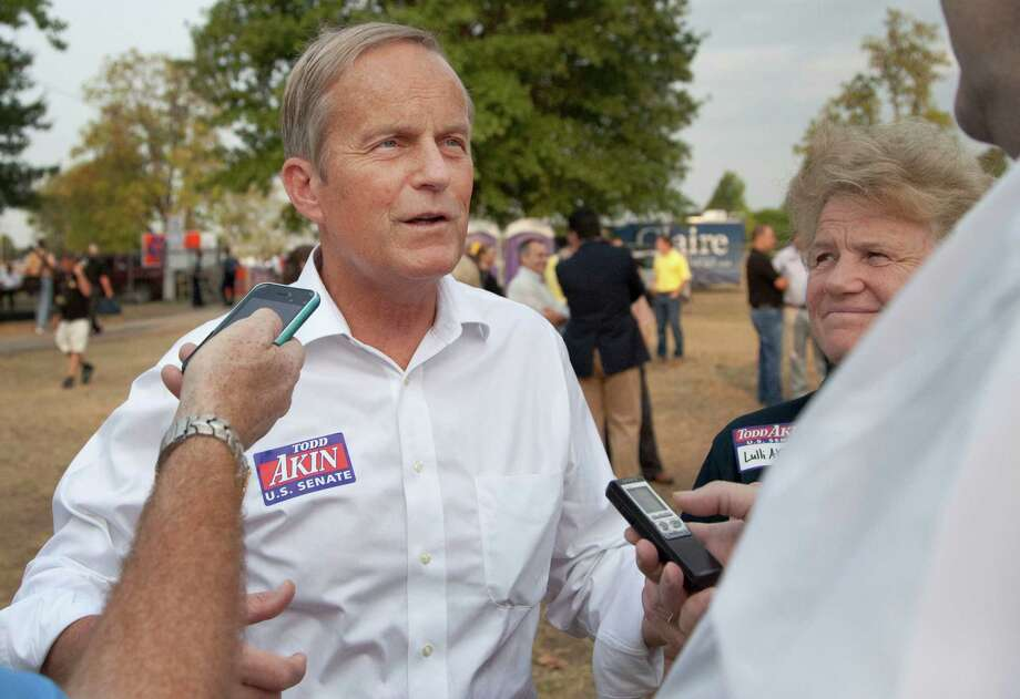 Rep. Todd Akin, R-Mo., and his wife, Lulli, talk with reporters last Thursday at the Governor's Ham Breakfast at the Missouri State Fair in Sedalia Photo: Orlin Wagner / AP