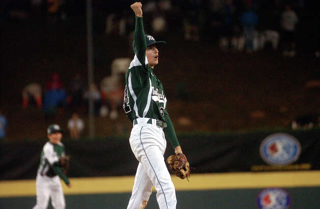 New England pitcher Will Lucas raises his arm into the air after the team beat Great Lakes 4-0, during 2012 Little League World Series game action in South Williamsport, Penn. on Monday August 20, 2012. Photo: Christian Abraham / Connecticut Post