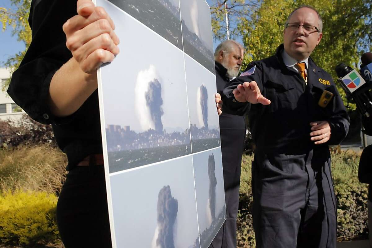 Dr. Daniel Horowitz, Managing Director of the Chemical Safety Board, gestures to photos of the vapor plume as members of the Chemical Safety Board released an update on Monday, August 20, 2012 in Richmond, Calif., of the fire at the Chevron refinery that exploded on Aug. 6.