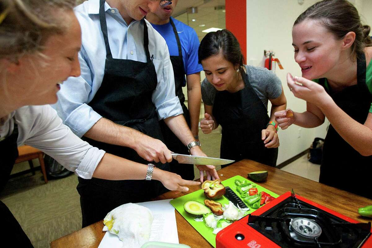 Second-year medical students, from left, Barcleigh Sandvall, Jeremy Slawin, Christopher Chu, Marina Masciale and Kailey Bolles work to create a pepper and avocado soup in a cooking class at Baylor College of Medicine.