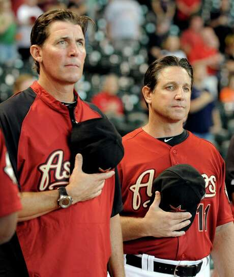 Houston Astros new interim manager Tony DeFrancesco, right, and new hitting coach Ty Van Burkleo stand for the national anthem before a baseball game against the Arizona Diamondbacks, Sunday, Aug. 19, 2012, in Houston. DeFrancesco replaced Brad Mills. (AP Photo/Pat Sullivan) Photo: Pat Sullivan / AP