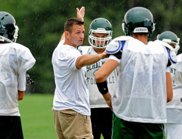 Schalmont football coach Joe Whipple instructs his players on the next drill during practice at the school on Friday, Aug. 17, 2012 in Rotterdam, N.Y. (Lori Van Buren / Times Union) Photo: Lori Van Buren