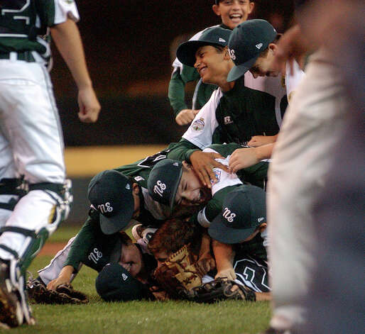 New England teammates pile onto pitcher Will Lucas, during 2012 Little League World Series game action against Great Lakes in South Williamsport, Penn. on Monday August 20, 2012. Photo: Christian Abraham / Connecticut Post